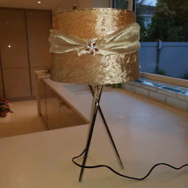 Velvet tripod table lamp with crystal brooch.
