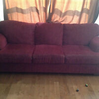 2 beautiful red couches
