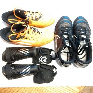 2 pairs of soccer cleats and 1 pair of shin guards