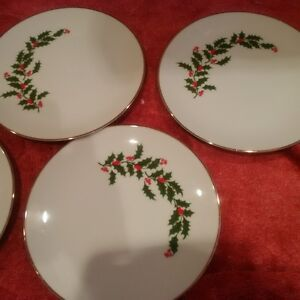 Four dessert plates. All matching Christmas pattern