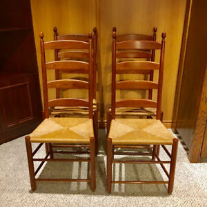 four Ethan Allen ladder back chairs with woven seats