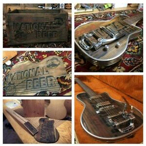 CUSTOM GUITAR MADE FROM A 1930'S BEER CRATE AND 50'S DINER TABLE