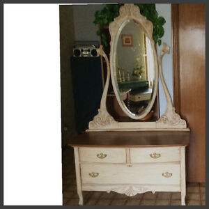 Antique lowboy dresser and mirror.