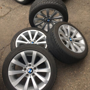 set of 4 - 17 inch BMW rims & tires