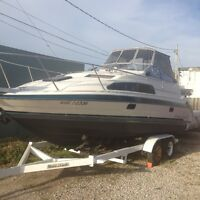 26.5 FT    1991 Bayliner with tandem-axle trailer