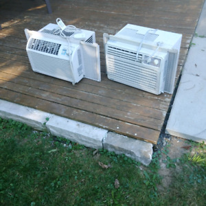 Two Window Air Conditioners.
