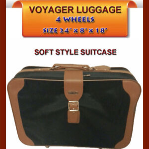 GREAT VOYAGER LUGGAGE WITH 4 WHEELS IN EXCELLENT CONDITION