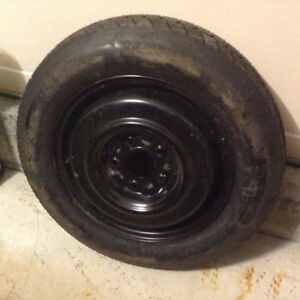 """16"""" DONUT TIRE AND RIM ( full circumference - 25 1/4"""" ) $ 95.00"""