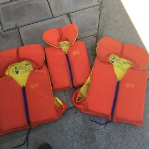 THREE LIKE NEW LIFE JACKETS