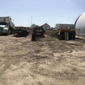 fenced stoage  lot with quonset