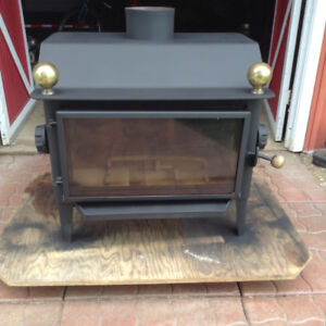 """Wood Stove 1/4"""" Cast Iron $550 Firm"""