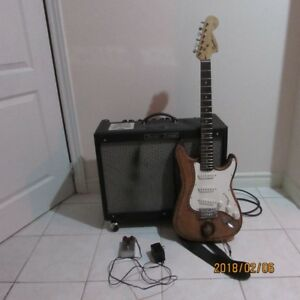 fender deluxe tube amp, fender squier strat with soft case and s