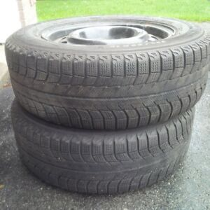 pair of Michelin x-ice winter tires on 5-bolt rims 225/60/R16