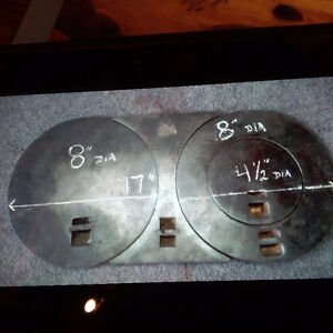 Wood stove, top covers.   $ 25.00