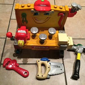TONKA *talking, moving tool bench* with tools included.