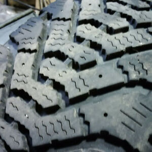 Four 205 75 R14 Goodyear Nordic Snow Tires on Dodge Rims