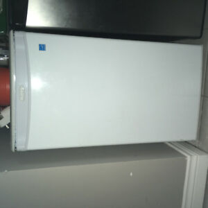 Selling white mini fridge