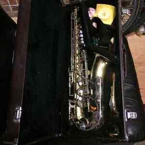 Alto saxophone with hard case