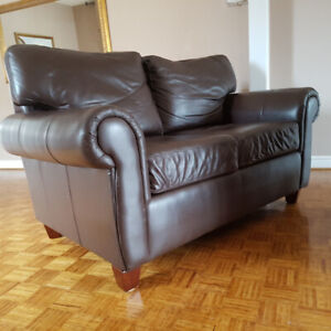 Two Identical Brown leather Loveseats