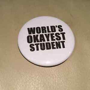 'World's Okayest Student' backpack pin