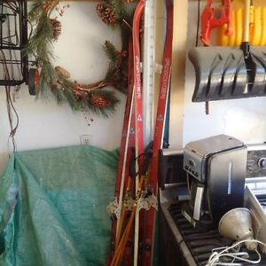 skis and poles two sets