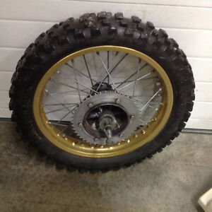 86 CanAm ASE 200 motorcycle various parts for sale.