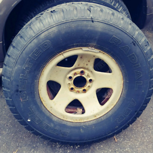 Used 31x10.50r15lt Full sized spare tire with rim