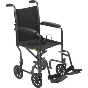 new in box TRANSPORT wheelchair fold light weight T 647-781-8987