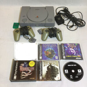 Sony Playstation, 2 controllers, and 5 games