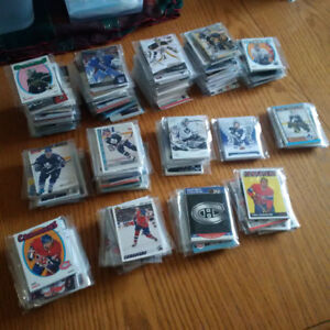 Packs of hockey cards and baseball cards, LOOK