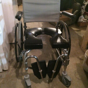 Wheel chair shower commode