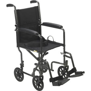 Transport Wheelchair - Easy to fold - Comes with footrest