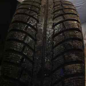 Winter tires + rims + wheel covers for sale