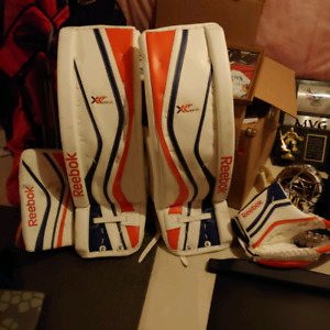 Reebok goalie pads and gloves. Edmonton Oilers colours. 35 plus