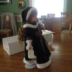 Regal collectible doll on stand in box