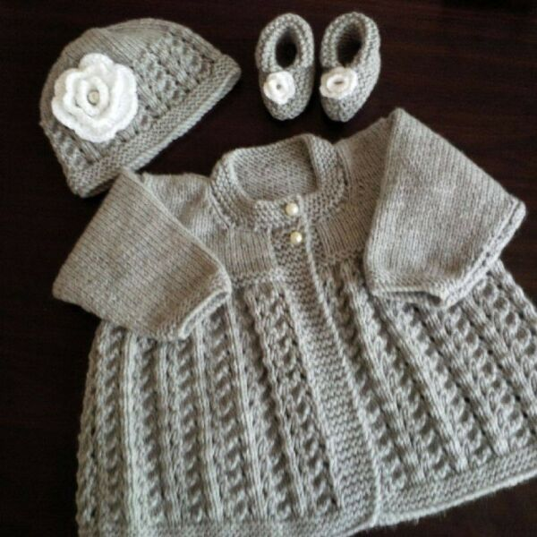 Hand knitted baby grow sets, shawls, and Christening gowns, ponchos and more