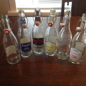 ASSORTED BOTTLES WITH ATTACHED STOPPERS ( 7 included)