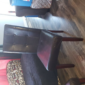 Solid Kitchen Table in great shape  4 comfy leather chairs