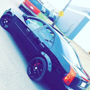 BLACK ON BLACK CADILLAC CTS