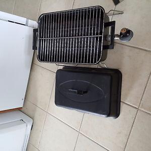 Small portable propane barbecue