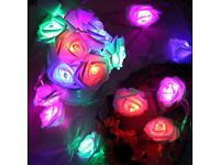 Attractive string of 100 rose shaped multi-coloured lights 10 metres long