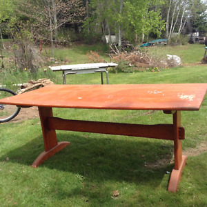 solid wood trestle table and two chairs