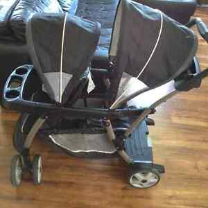 Double canopy sit n stand stroller