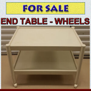 WHITE END TABLE ON WHEELS - REASONABLY PRICED TO SELL