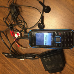 Used Nokia XpressMusic cellphone with earbud/Mic & charger