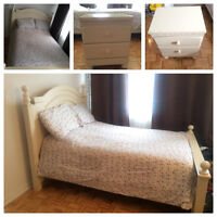 Bed (& mattress) and bedside table.