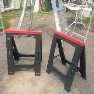 TWO PLASTIC 30 INCH HIGH SAW HORSE STANDS-GOOD CONDITION