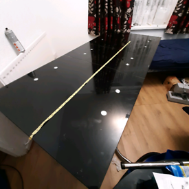 Black glass Extending dining table for 6 to 12