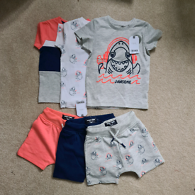 New with tags, 9-12month baby boy matching T-shirt and short sets.
