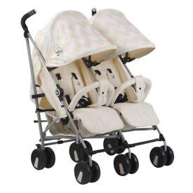 My babiie double buggy/stroller